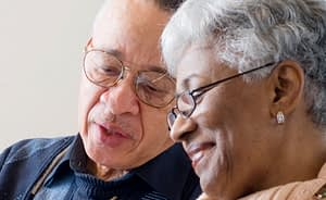 older couple looking at a legal document