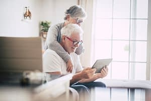 older couple looking at an ipad