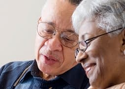 older couple looking at a document